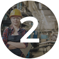 employee in hard hat crossing arms
